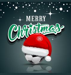 merry christmas santa hat on soccer ball vector image vector image