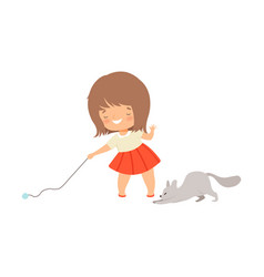 Little girl playing with her cat using ball of vector
