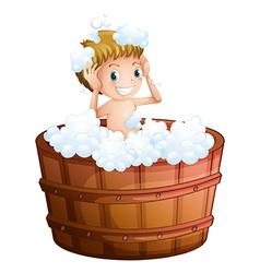 A young boy taking bath at the big bathtub vector