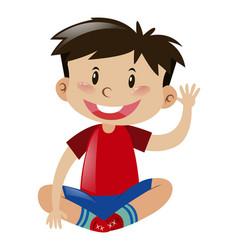 Little boy in red shirt waving hand vector