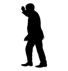 Silhouette of a man with his hand raised vector