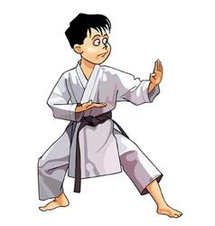 cartoon karate boy dressed in a kimono standing vector image