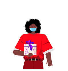 santa woman in mask holding gift box new year vector image