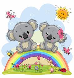 Two koalas are sitting on the rainbow vector