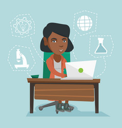 Young african-american student working on a laptop vector