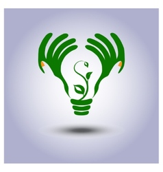 Green ecology light bulb icon in hands vector image vector image