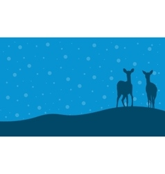 Silhouette of two deer in hill scenery vector image vector image