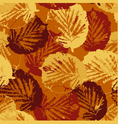 seamless texture of leaves on warm background vector image