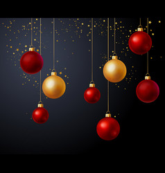 Christmas gold and red balls over black background vector
