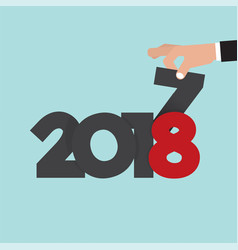 hand changing 2017 to 2018 vector image
