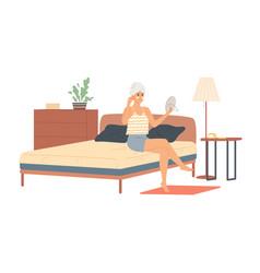 Woman in bedroom applies night cream to her vector