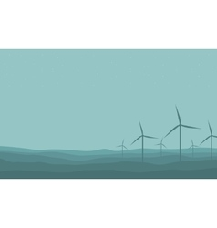Silhouette of many windmill on farm scenery vector image