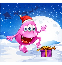 A happy pink beanie monster wearing santas hat vector