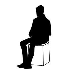 man sitting on box stencil vector image