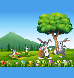 happy bunnies playing on the nature background vector image