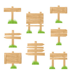wooden sign standing in green grass vector image