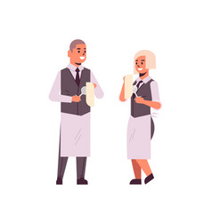 Professional waiters couple polishing wine glasses vector