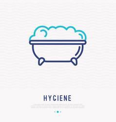 bathtub with bubbles thin line icon vector image
