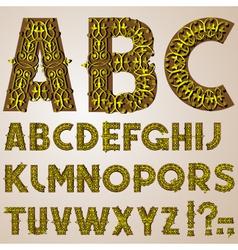 golden swirly alphabet vector image