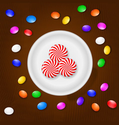 Colored candies sweets and lollipops on a brown vector