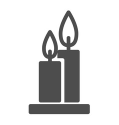 Two burning candles solid icon flames web vector