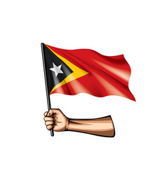 East timor flag and hand on white background vector