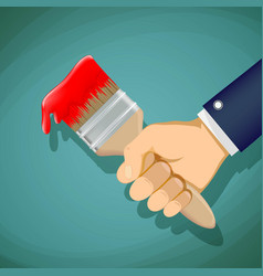 man holds in his hand a paintbrush repair vector image