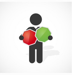 black silhouette of a man holds red and green sign vector image