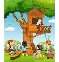 Children playing at the treehouse in the garden vector image vector image