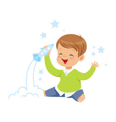 Cute little boy playing with rocket toy kids vector