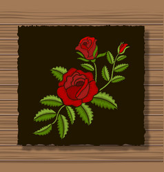 Embroidery roses and sprigs on a dark flap cloth vector