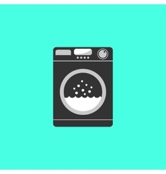 black washing machine isolated on green background vector image vector image
