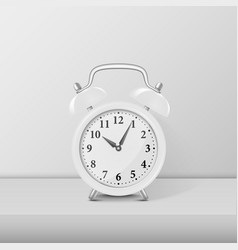 White alarm clock closeup standing on white table vector