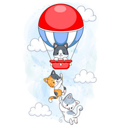 Cute kittens hanging on hot air balloon flying in vector