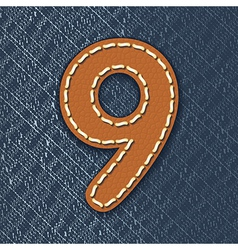 Number 9 made from leather on jeans background vector image