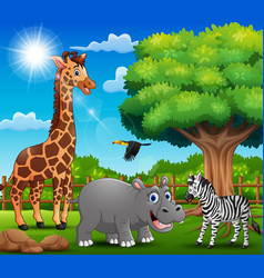 The animals are enjoying nature by the cage vector