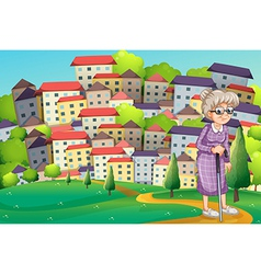 A grandmother with cane walking at the hilltop vector