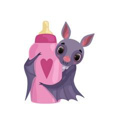 cute bat holding pink milk bottle funny creature vector image
