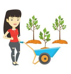 Woman pushing wheelbarrow with plant vector