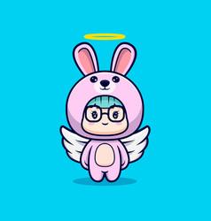 Cute angel girl wearing bunny costume vector