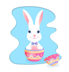 Funny bunny sitting in an easter egg vector