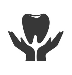 Silhouette hand holding a tooth vector