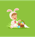 cute little boy in a white bunny costume sitting vector image