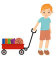 young happy little boy playing with red wagon vector image vector image