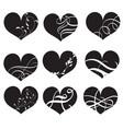set of black hearts with flourish hand vector image