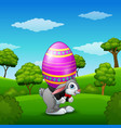 cartoon easter bunny carrying easter eggs in the p vector image