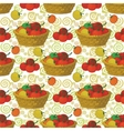Seamless pattern baskets and tomatoes vector image vector image