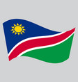 flag of namibia waving on gray background vector image vector image