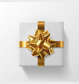 realistic 3d white gift with gold ribbons vector image vector image
