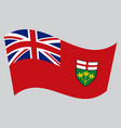 flag of ontario waving on gray background vector image vector image